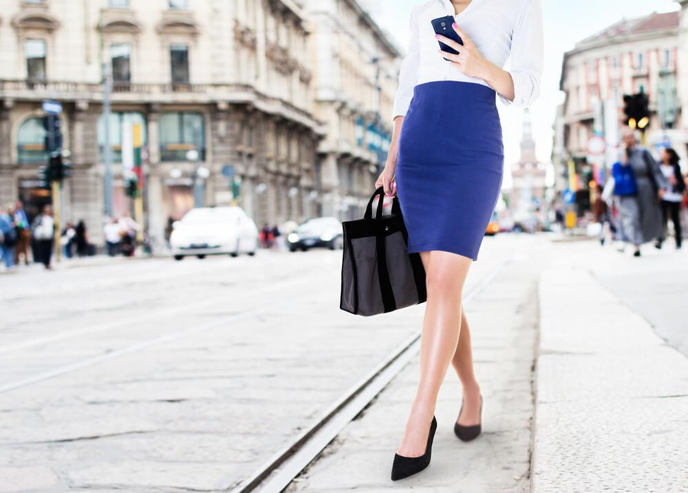 woman in navy skirt
