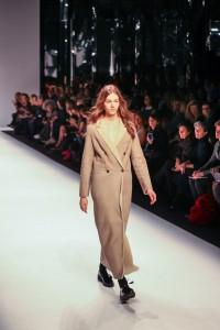 Model wears full length coat