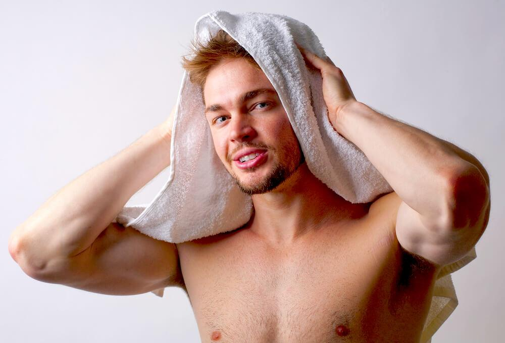 man toweling hair dry