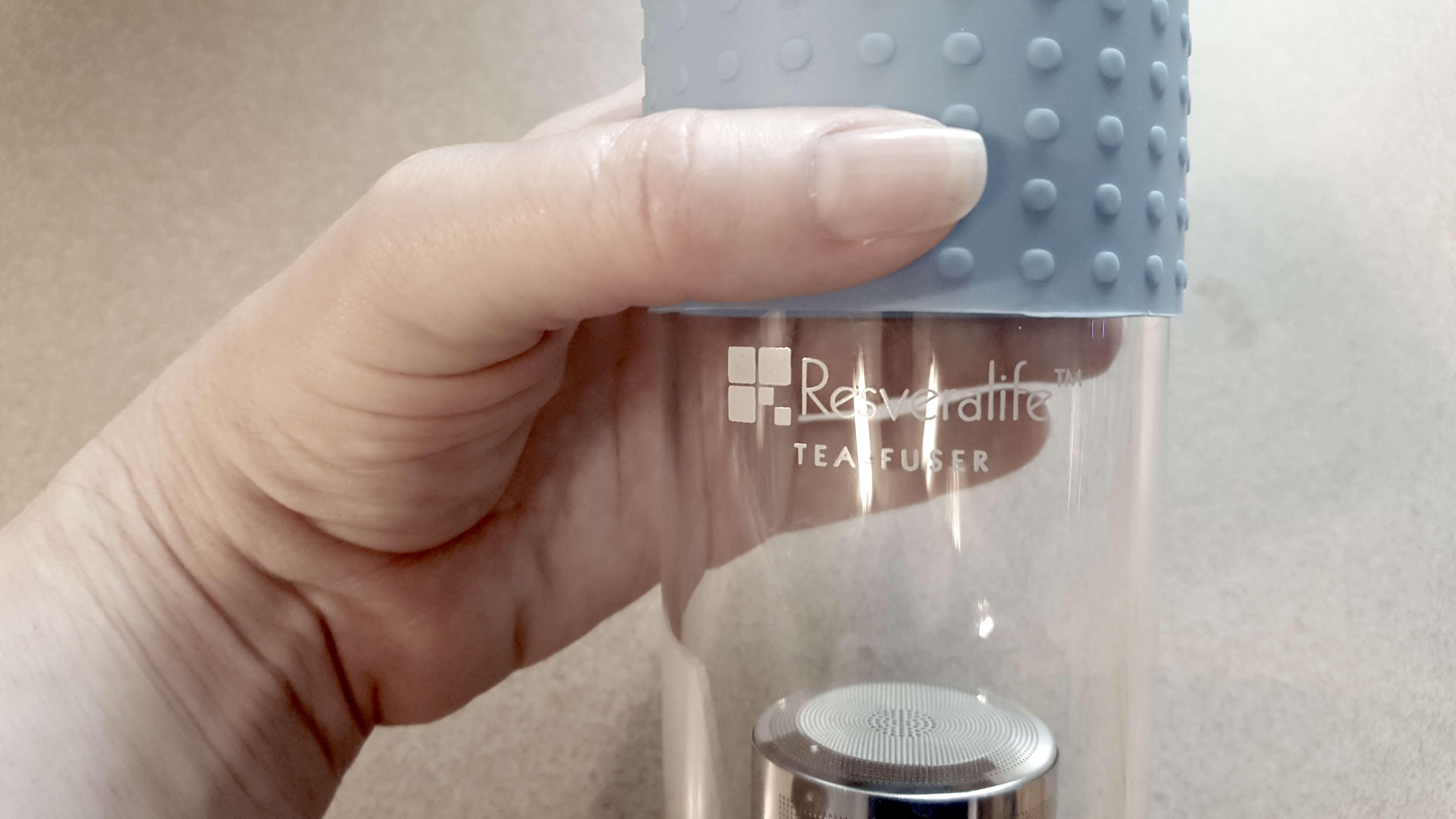 holding Resveralife tea infuser