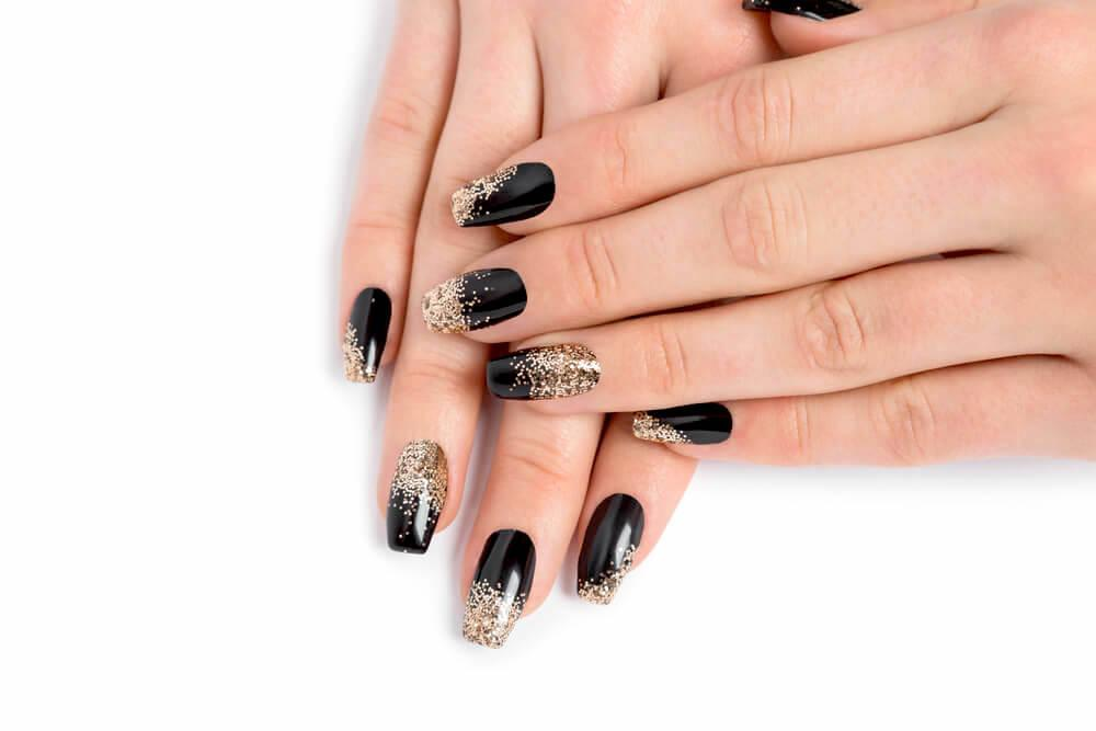 black and gold ombre nail design