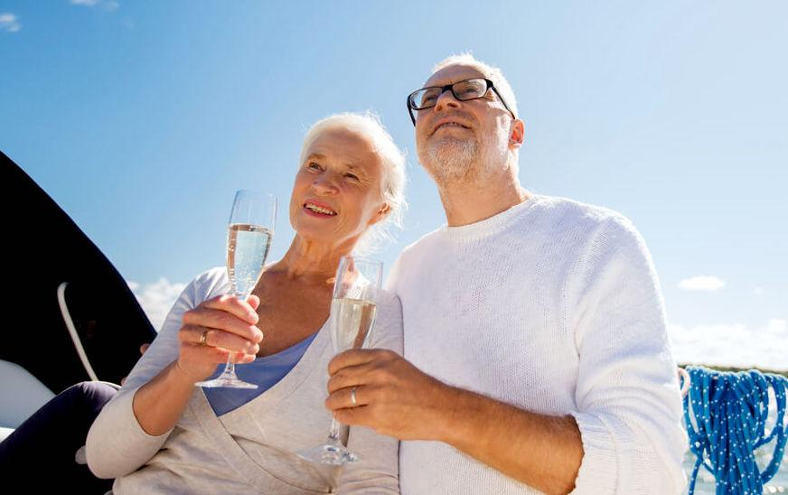 Senior couple enjoying champagne on a cruise