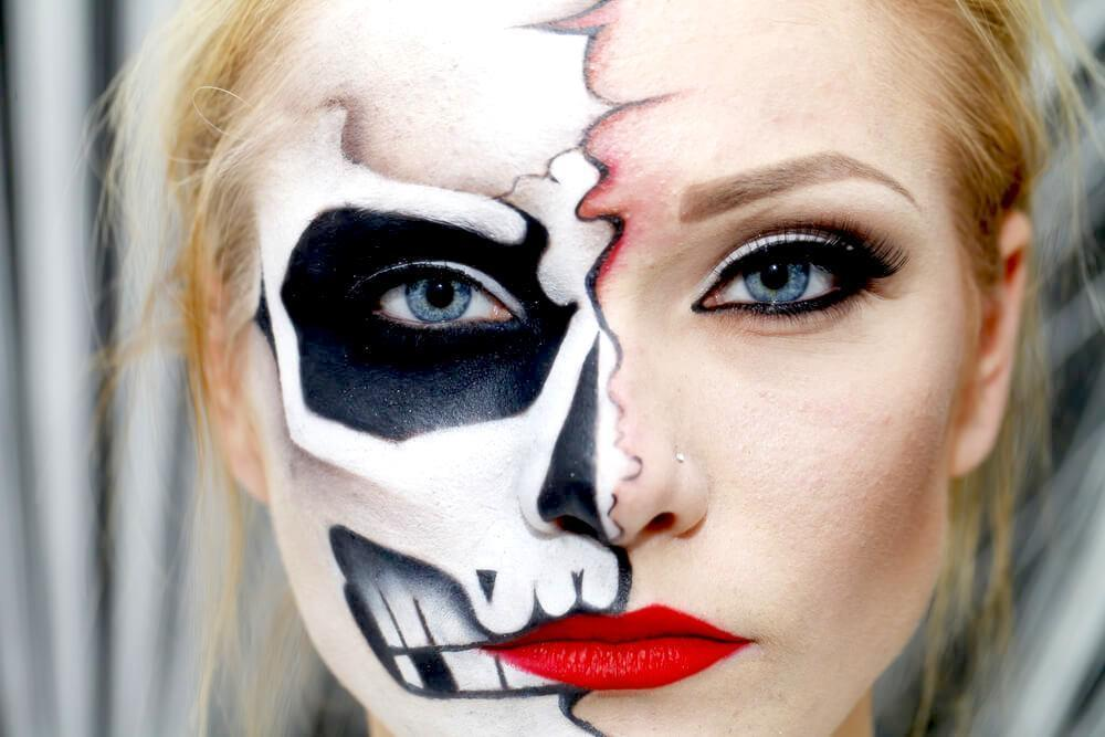 Young unidentified woman with scary skull makeup