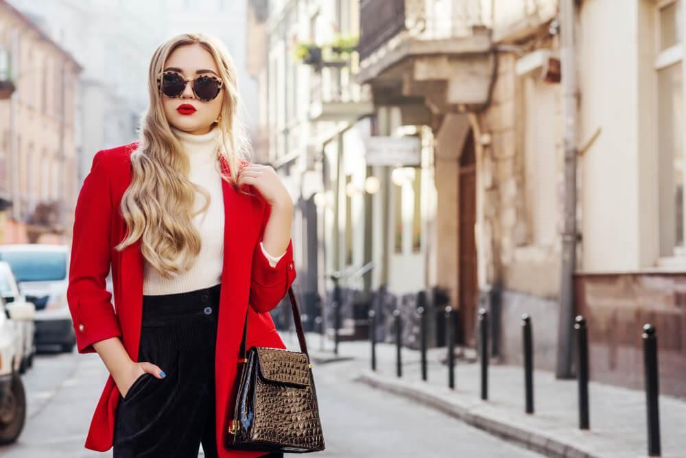 Fashionable woman in red coat and white turtleneck sweater