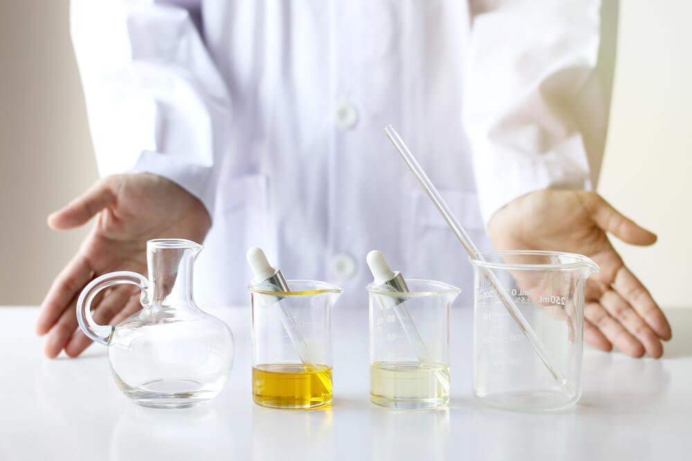 Scientist making a blend of oils