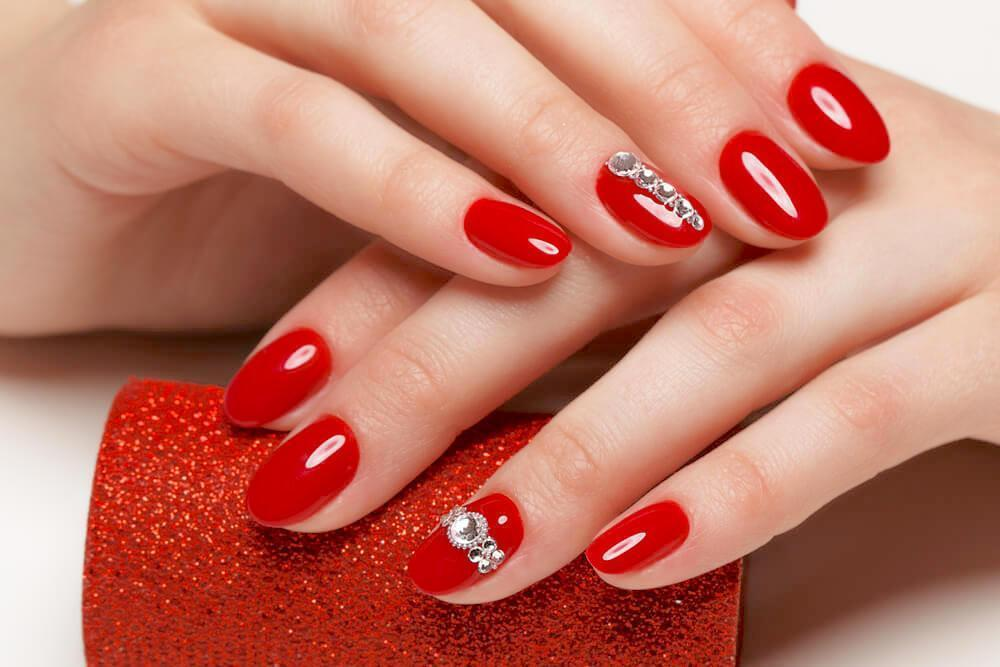 Red nail design with rhinestones