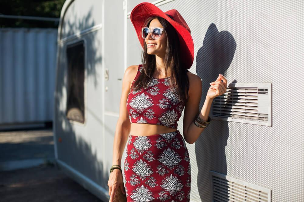 Fashionable woman in red dress and red hat