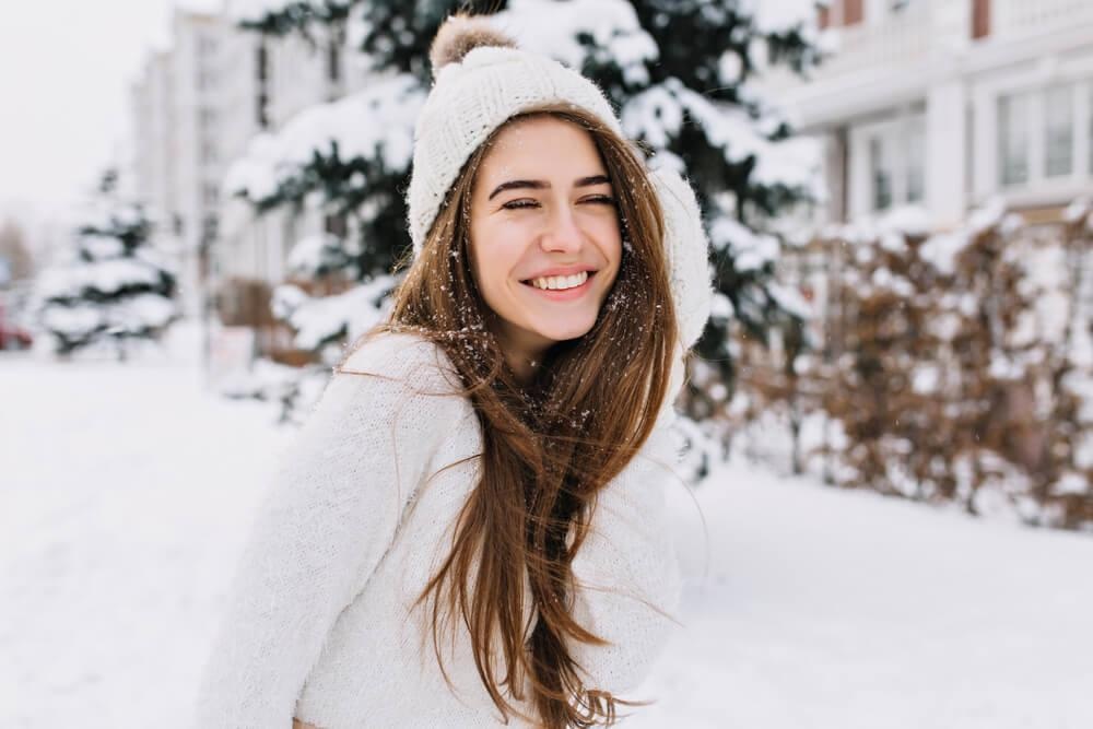 Woman with no makeup outdoors in snow