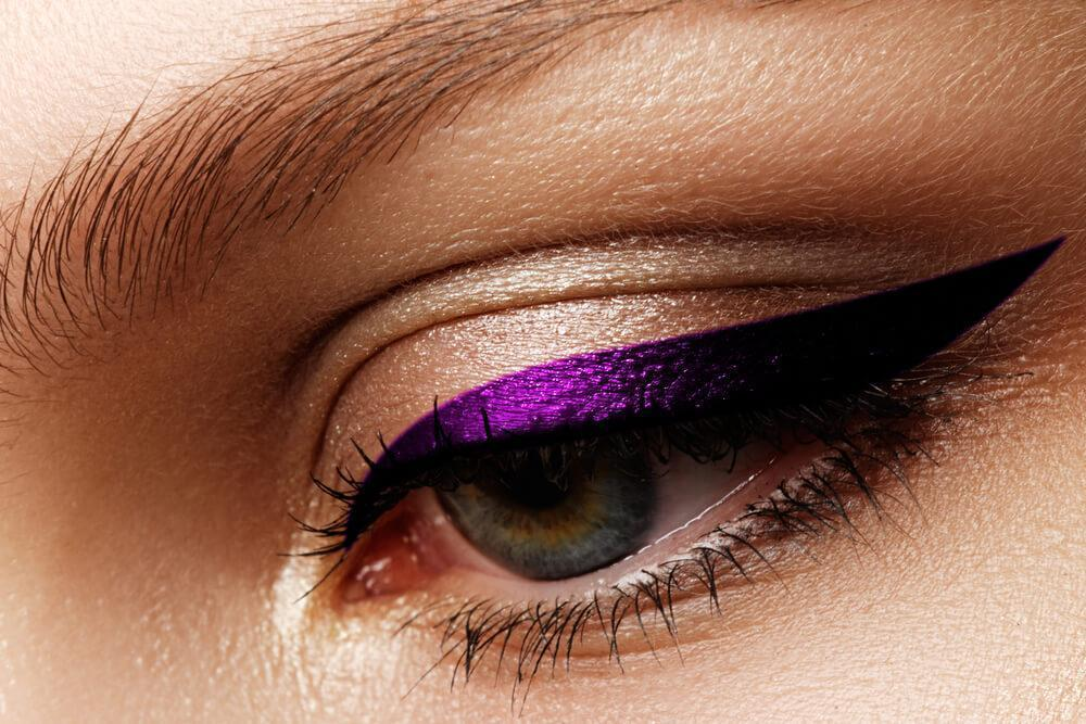 Close-up of purple winged eyeliner