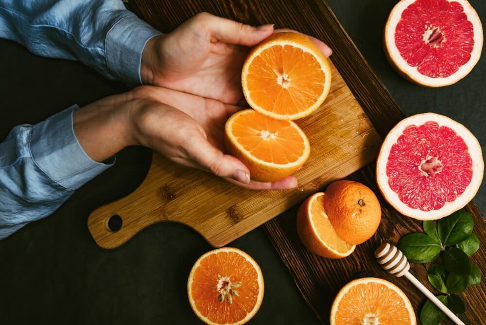 Hands holding citrus fruit