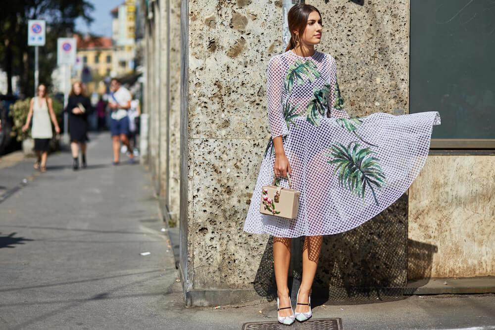 Woman in printed dress on street