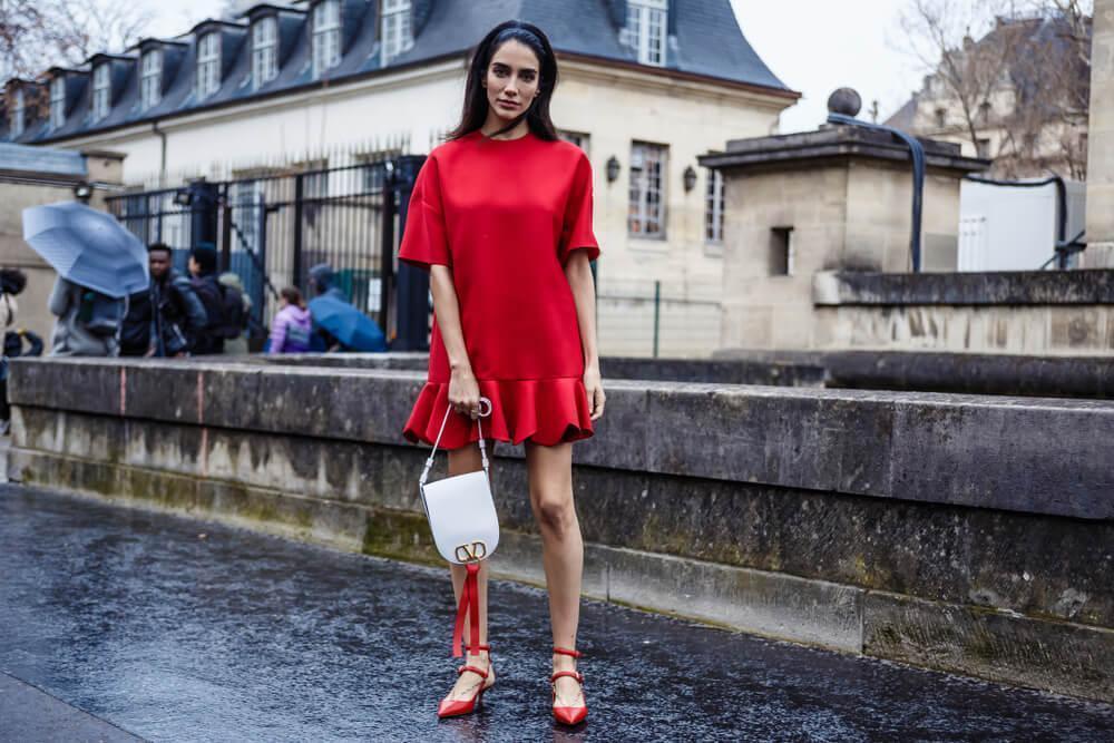 Woman in red dress on street