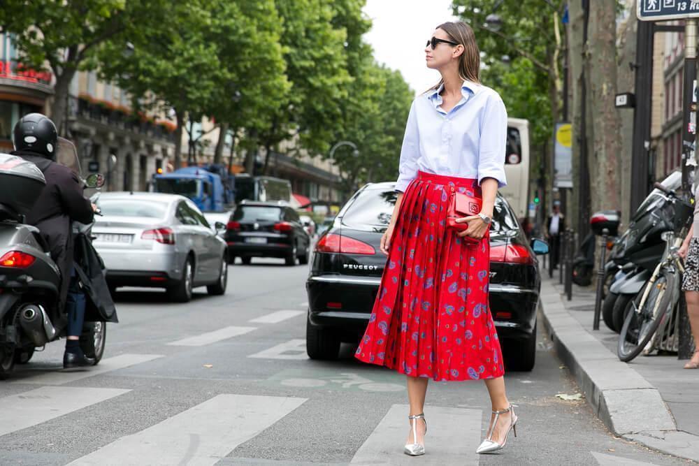 Woman in printed skirt on street