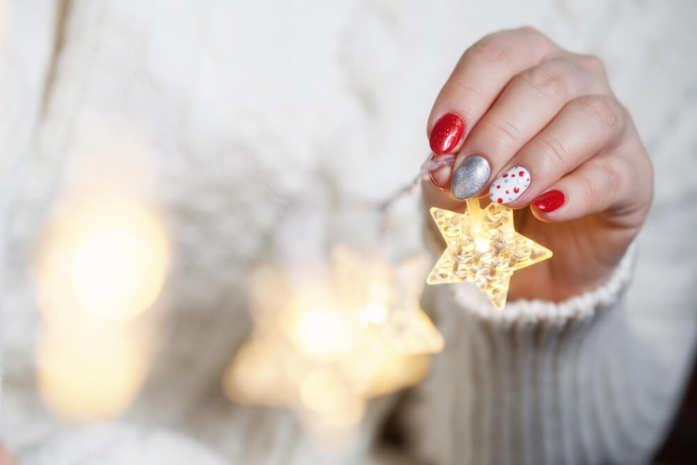 Nail art holding holiday decorations