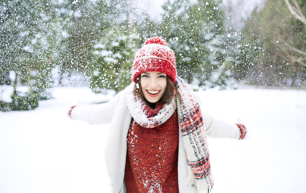 Woman in snow with hat