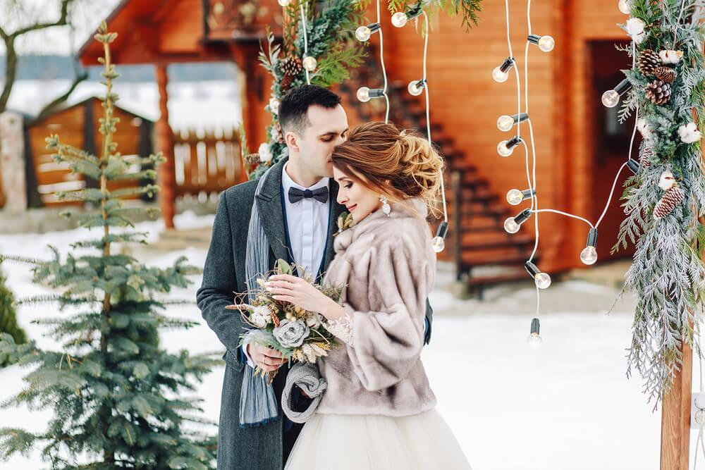 Happy young couple getting married, winter style