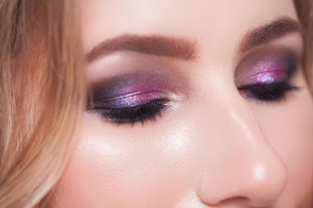 Unknown woman with metallic purple eyeshadow