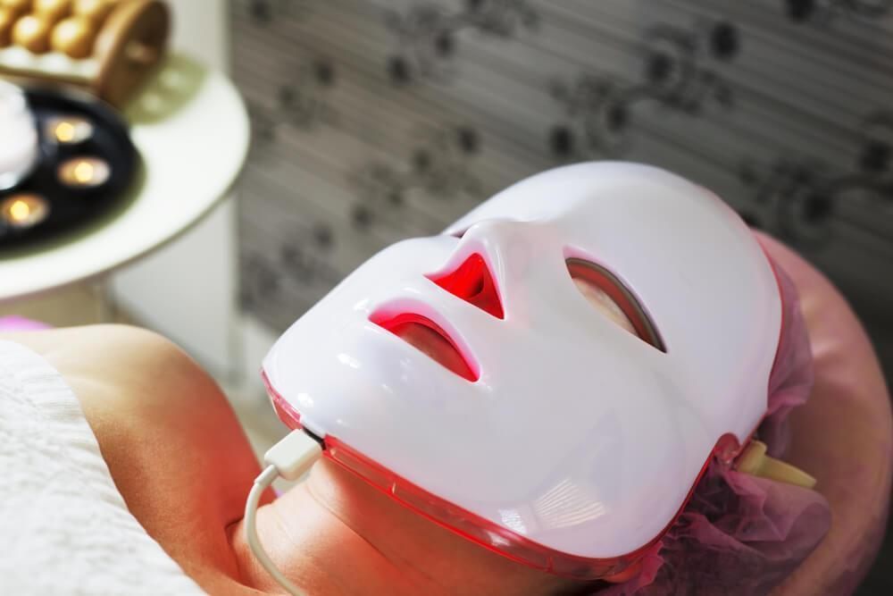 Woman wearing LED skincare mask